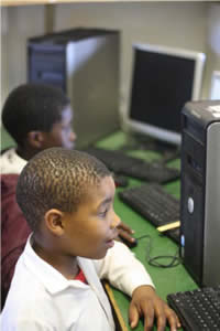 Volunteer in Schools in South Africa teaching computer literacy