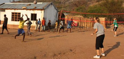 Volunteer coaching sports with children in Malawi