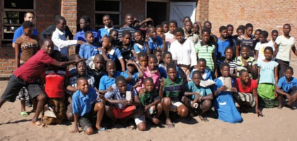 Volunteer with African children in rural schools in Malawi